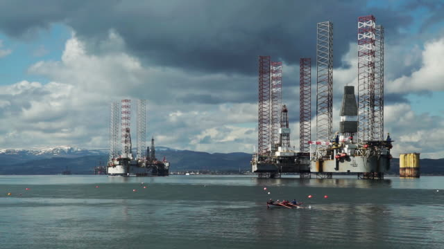 active seniors in rowing boat near oil drilling platform - environmentalist stock videos & royalty-free footage