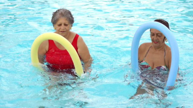 active seniors in the swimming pool - 70 79 years stock videos & royalty-free footage