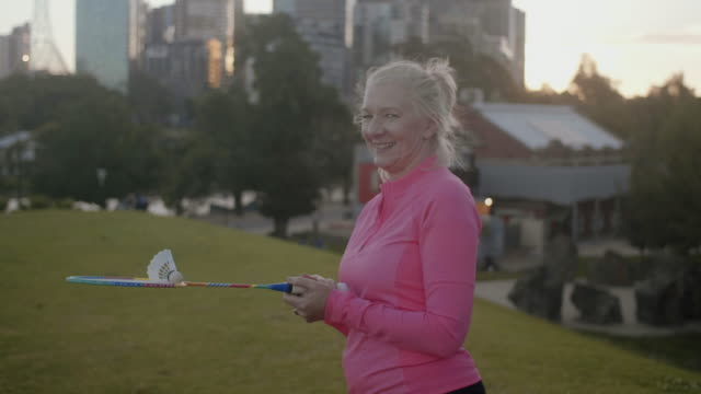 active seniors playing badminton (slow motion) - leisure activity stock videos & royalty-free footage