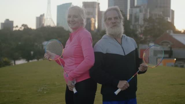 active seniors playing badminton - leisure activity stock videos & royalty-free footage