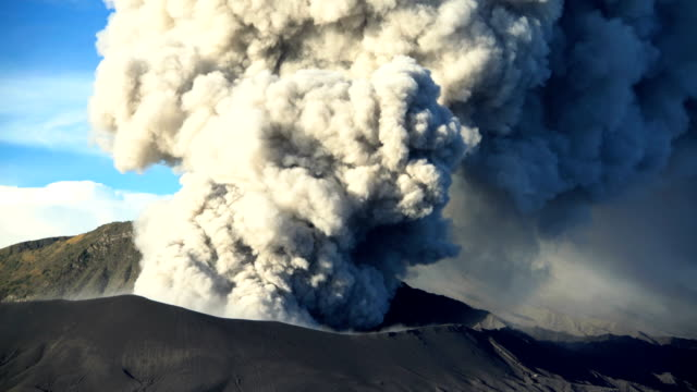 active volcano mt bromo erupting smoke java indonesia - indonesia stock-videos und b-roll-filmmaterial