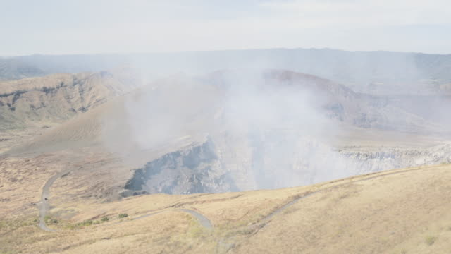 active volcano nindiri wide shot angle. in this 4k video footage we can see the crater expelling steam with sulfur. placed in masaya ( managua - nicaragua - central america ). - managua stock videos & royalty-free footage
