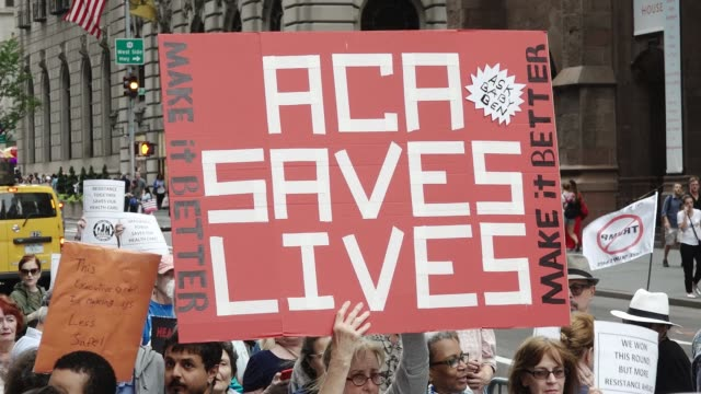 activist and health-care advocates held a rally at the 5th avenue trump tower titled 'our lives are still on the line: celebration & recommitment... - medicaid stock videos & royalty-free footage