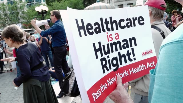 activist and health-care advocates held a rally in union square demanding universal health-care , improved medicare, and end to for-profit... - medicare stock videos & royalty-free footage