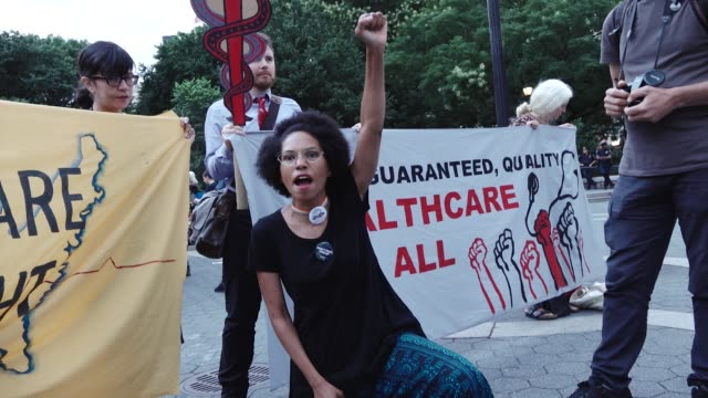 activist and health-care advocates held a rally in union square demanding universal health-care , improved medicare, and end to for-profit... - medicaid stock videos & royalty-free footage