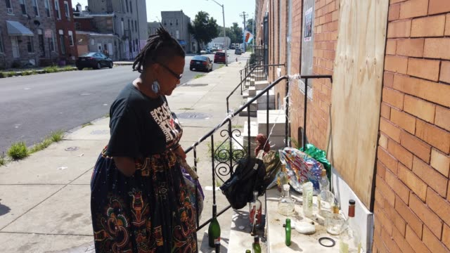 activist erricka bridgeford of baltimore ceasefire prays as she participates in a sacred space ritual near where a person was recently murdered on... - murder victim stock videos & royalty-free footage