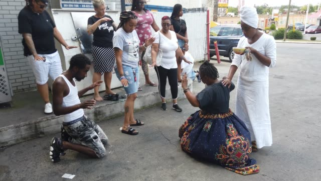 """activist erricka bridgeford of baltimore ceasefire prays as she participates in a """"sacred space"""" ritual near where a person was recently murdered on... - murder victim stock videos & royalty-free footage"""