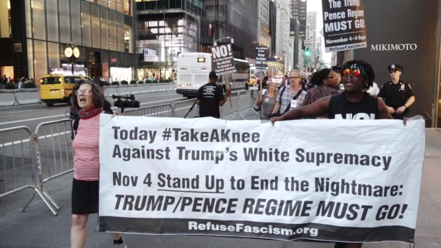activist from refusefascism gathered at manhattan's grand army plaza on 58th and 5th avenue and marched one block to the 5th avenue trump tower upon... - kneeling stock videos & royalty-free footage