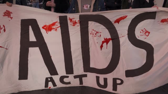 activist from the organization 'act up' activist rallied in duffy square times square in light of the upcoming annual world aids day. the rally... - banner sign stock videos & royalty-free footage