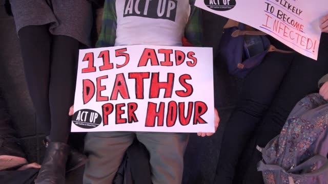 activist from the organization 'act up' activist rallied in duffy square times square in light of the upcoming annual world aids day. the rally... - retrovirus stock videos & royalty-free footage