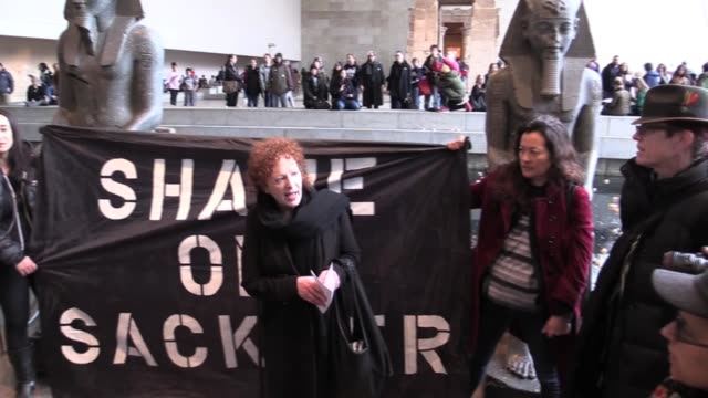 Activist Nan Goldin and 100 Sackler PAIN protesters tossed a thousand bottles of Oxycontin in the moat of the Temple of Dendur in the Sackler wing of...