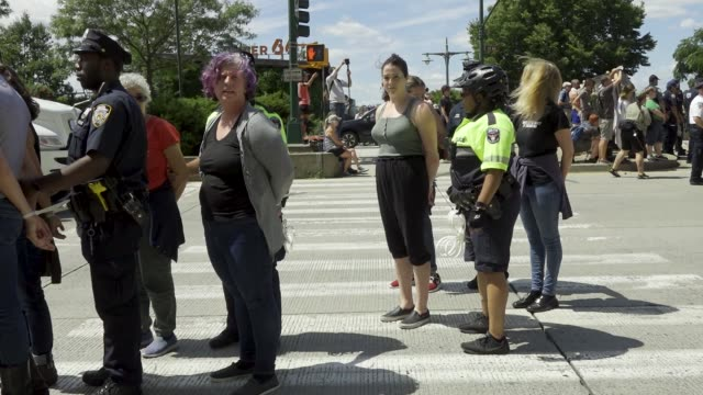 activist rallied at manhattan's madison square park and marched to the ice homeland security investigations office building demanding the closure of... - ice us homeland security stock videos & royalty-free footage