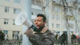 Activist riot. Megaphone shouting. Loudspeaker activism riot. Strike protest 4k.