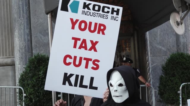 activist 'rise and resist' gathered in central park and marched to the 740 park avenue home of david koch to express their views on the consequences... - medicaid stock videos & royalty-free footage