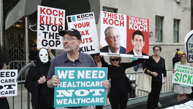 activist 'rise and resist' gathered in central park and marched to the 740 park avenue home of david koch to express their views on the consequences... - medicaid stock videos and b-roll footage