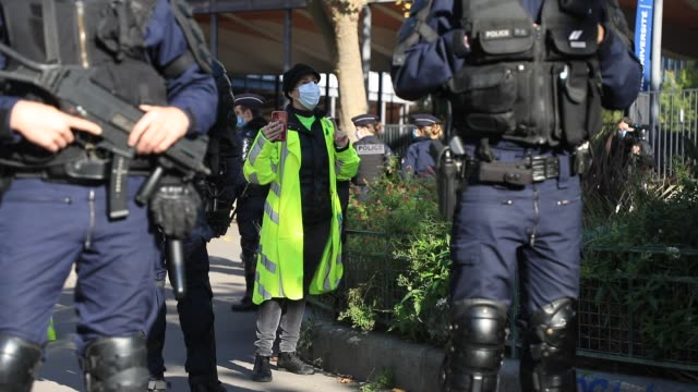activist sophie tissier is checked by the police during a demonstration of the yellow vests from the collective 'yellow force' against the lockdown,... - french culture stock videos & royalty-free footage