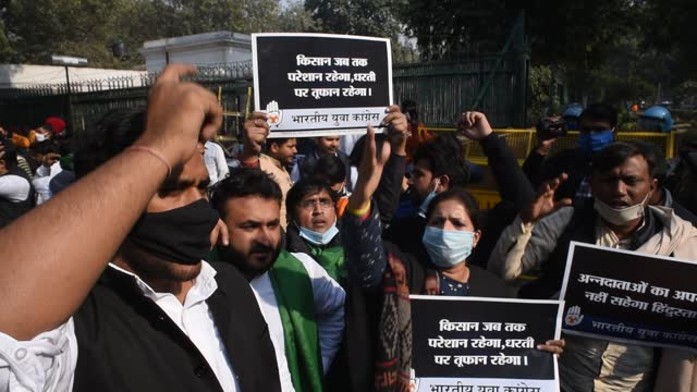 activists and supporters of indian youth congress hold placards as they shout anti government slogans during a protest against the new farm laws on... - farm stock videos & royalty-free footage