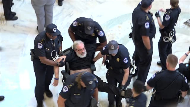 activists are arrested by us capitol police in the russell rotunda in protest of the supreme court nomination of judge brett kavanaugh amid... - rotunda stock videos & royalty-free footage
