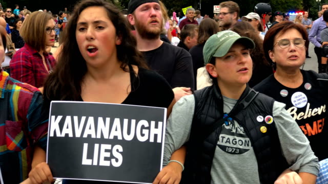 Activists block a street in front of the US Supreme Court to protest against the confirmation of Judge Brett Kavanaugh to the Supreme Court October 6...