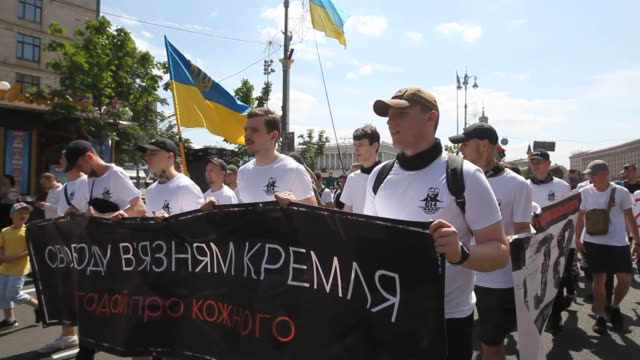 Activists carry a banner 'Freedom to the Kremlin prisoners' and shout slogans during their march on the Independence Square in Kiev Ukraine on 01...
