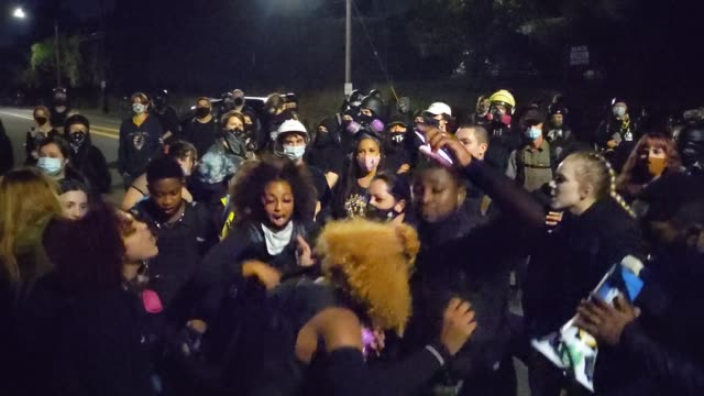 activists chant while marching to the kelly penumbra police building during a protest against racial injustice and police brutality on october 2,... - unfairness stock videos & royalty-free footage