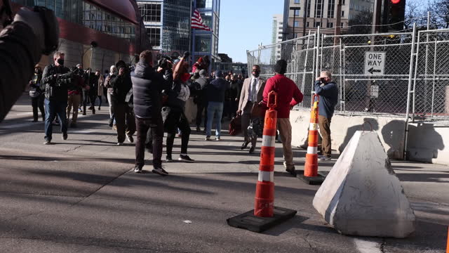 activists gather outside of the hennepin county government center before the start of the trial of former minneapolis police officer derek chauvin in... - live broadcast stock videos & royalty-free footage