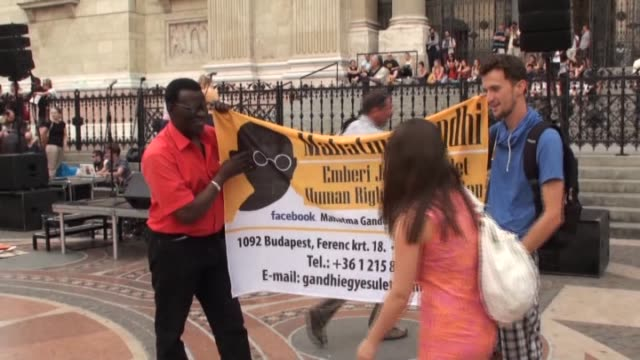 stockvideo's en b-roll-footage met activists hold a protest in front of the saint stephens basilica in budapest demanding the hungarian government to abandon construction of an... - oost europese cultuur