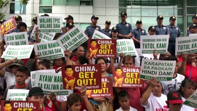 activists hold a protest outside the chinese embassy in manila for the second day against chinese president xi jinping's state visit to the... - south east asia stock videos & royalty-free footage