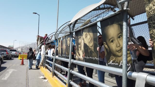 activists hold photos of migrant children who died trying to cross the u.s.-mexico border on june 27 in ciudad juarez, mexico. el paso bishop mark... - national border stock videos & royalty-free footage