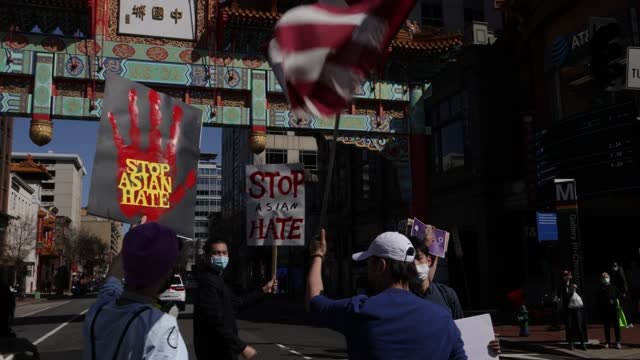 """activists hold signs that say """"stop asian hate"""" as they march toward chinatown after a """"dc rally for collective safety - protect asian/aapi... - pacific islanders stock videos & royalty-free footage"""