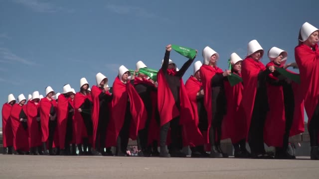 Activists in favour of the legalization of abortion dress up as characters from Margaret Atwood's feminist novel The Handmaid's Tale as they stage a...