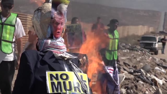 Activists in northwestern Mexico who support migrants burned an effigy of US President Donald Trump on Saturday in protest against the prototypes for...