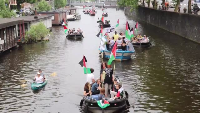 activists in the dutch capital amsterdam on june 01 2018 supported a boat parade that protests the decadelong israeli blockade in gaza organized by... - historical palestine stock videos & royalty-free footage