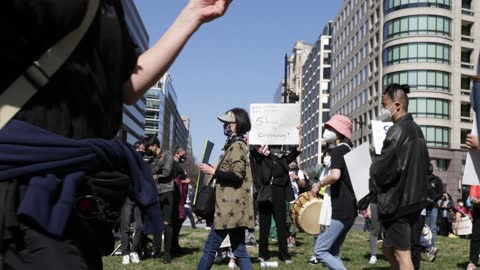 """activists march with signs and bang on percussion instruments as they participate in a """"dc rally for collective safety - protect asian/aapi... - pacific islander stock videos & royalty-free footage"""