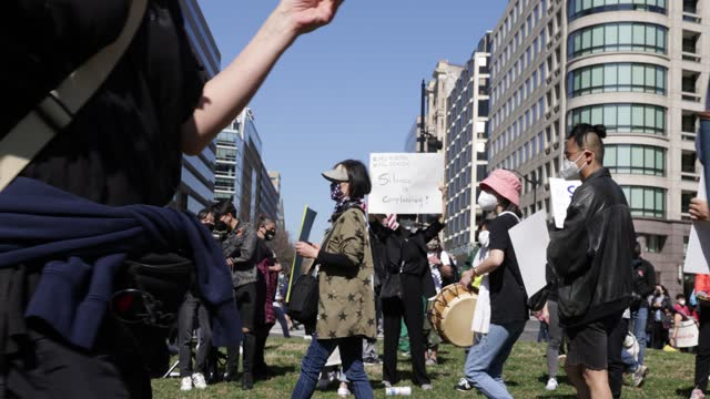 "activists march with signs and bang on percussion instruments as they participate in a ""dc rally for collective safety - protect asian/aapi... - oceaniskt ursprung bildbanksvideor och videomaterial från bakom kulisserna"