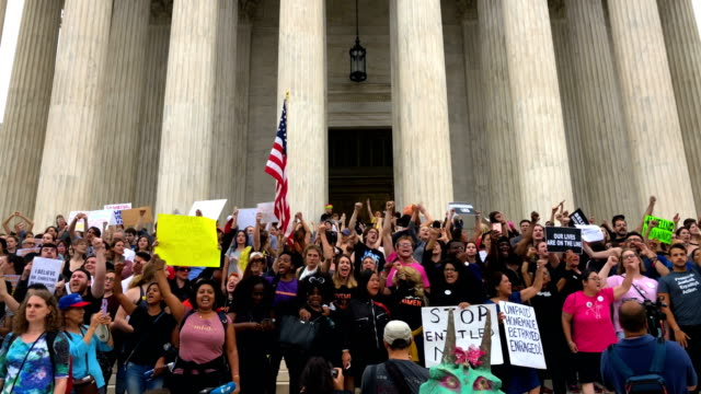 Activists occupy the front steps of the US Supreme Court to protest against the confirmation of Judge Brett Kavanaugh to the Supreme Court October 6...