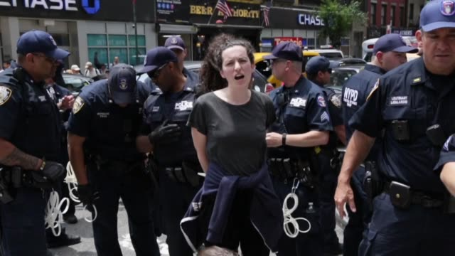 activists of extinction rebellion movement are arrested during a demonstration near the new york times building on june 22 2019 protest calling for... - ニューヨークタイムズ点の映像素材/bロール