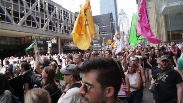 activists of extinction rebellion movement marched in from bryant park to the new york times in new york on june 22 2019 calling for the media to... - ニューヨークタイムズ点の映像素材/bロール