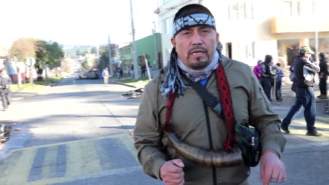 activists of the mapuche indigenous people denounce racism after chilean authorities and hate groups used force to clear demonstrators from... - {{relatedsearchurl(carousel.phrase)}} stock-videos und b-roll-filmmaterial