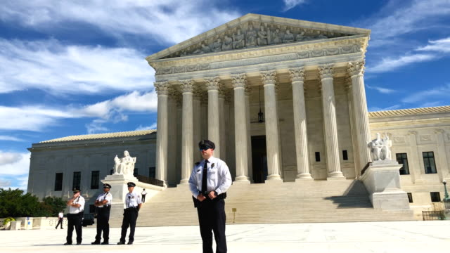 activists participate in a rally in front of the us supreme court september 28 2018 in washington dc activists staged a rally to call to drop the... - oberstes bundesgericht der usa stock-videos und b-roll-filmmaterial