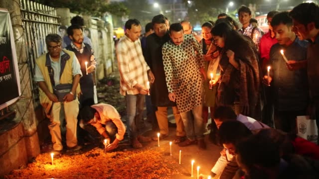 activists place candle lights in a show of respect to remembrance the american atheist blogger avijit roy who was murdered four year ago in dhaka,... - atheism stock videos & royalty-free footage