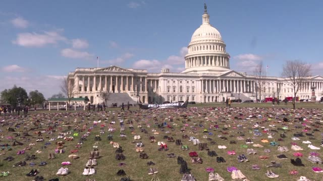 activists placed 7000 pairs of empty shoes in front of the us congress in a protest against the number of children killed in gun violence - pair stock videos and b-roll footage