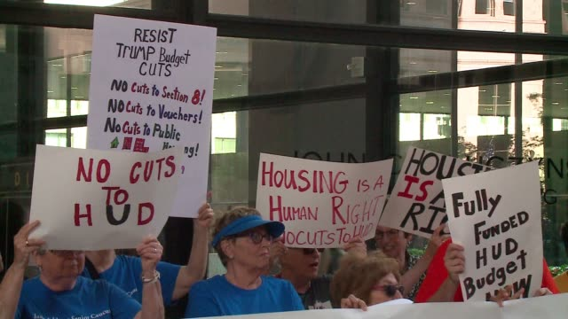 activists protest in chicago on july 6, 2017 against donald trump's budget plan for the department of housing and urban development , which would... - housing difficulties stock videos & royalty-free footage