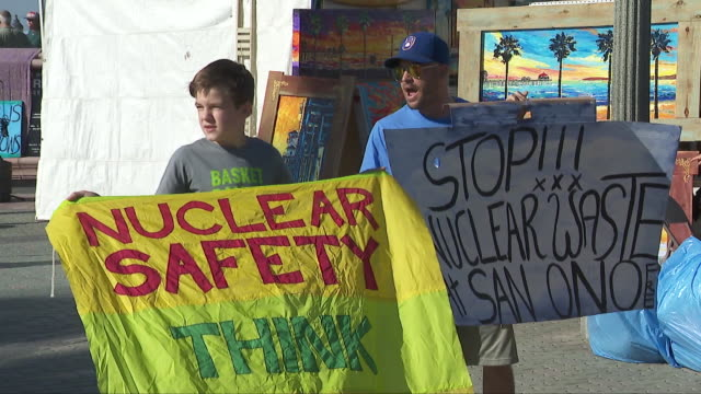 activists protest san diego-area nuclear waste storage facility in huntington beach. - toxic waste stock videos & royalty-free footage