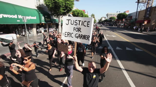 Activists protest the jury decisions not to indict police officers killing black people on December 6 2014 in Los Angeles California United States