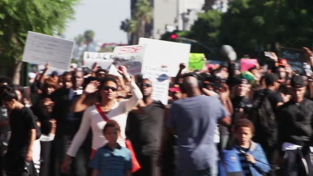 activists protest the jury decisions not to indict police officers killing black people on december 6 2014 in los angeles california united states - totschlag stock-videos und b-roll-filmmaterial
