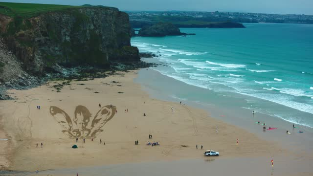 activists put the finishing touches to a sand drawing of the g7 leaders and calling on them to 'share the vaccine and waive the patents' on watergate... - 10 11 years stock videos & royalty-free footage