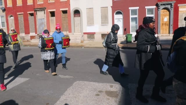 Activists residents and those that have lost a loved one to violence participate in a 'Peace and Healing Walk' in an area with a high rate of...