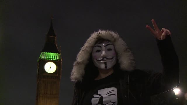 Activists scuffled with riot police in central London as thousands took part in a Million Mask March anti capitalist demonstration on Thursday night