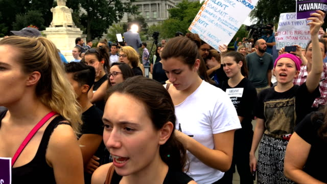 Activists shout slogans during a protest against the confirmation of Judge Brett Kavanaugh to the US Supreme Court in front of the US Supreme Court...